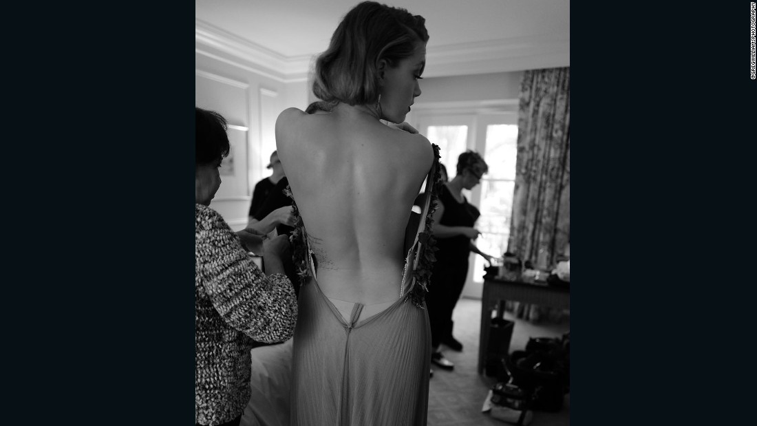 "As a part of his #artofbehindthescenes Williams is granted access to stars' hotel rooms. Here is <a href=""https://www.instagram.com/p/BAYOSKZG5In/?taken-by=gregwilliamsphotography"" target=""_blank"">Amber Heard </a>backstage getting ready for the Golden Globes."