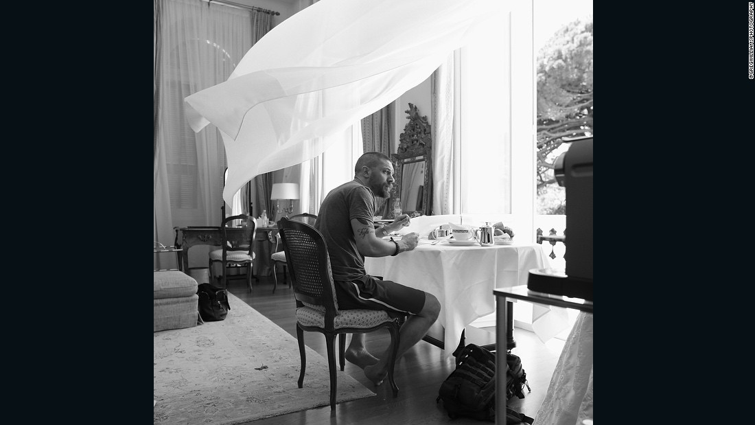 "Williams photographs<a href=""https://www.instagram.com/p/2tCZvMm5C7/"" target=""_blank""> Tom Hardy</a> having breakfast in his suite at the Hotel Du Cap the afternoon after the <em>Mad Max</em> premiere."