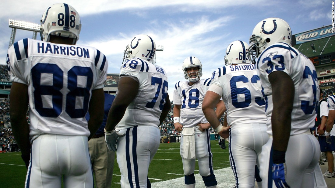 Manning stands on the sidelines with his Colts teammates during a game in 2006.