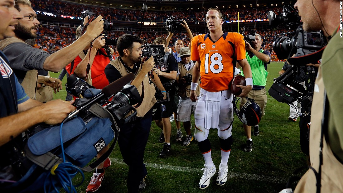 Manning walks off the field in 2012 after his first regular-season game as a Denver Bronco. He signed a five-year deal with the team after being released by the Colts.