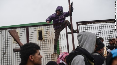 A child tries to flee Aleppo in February as thousands of Syrians tried to cross the Turkish border.