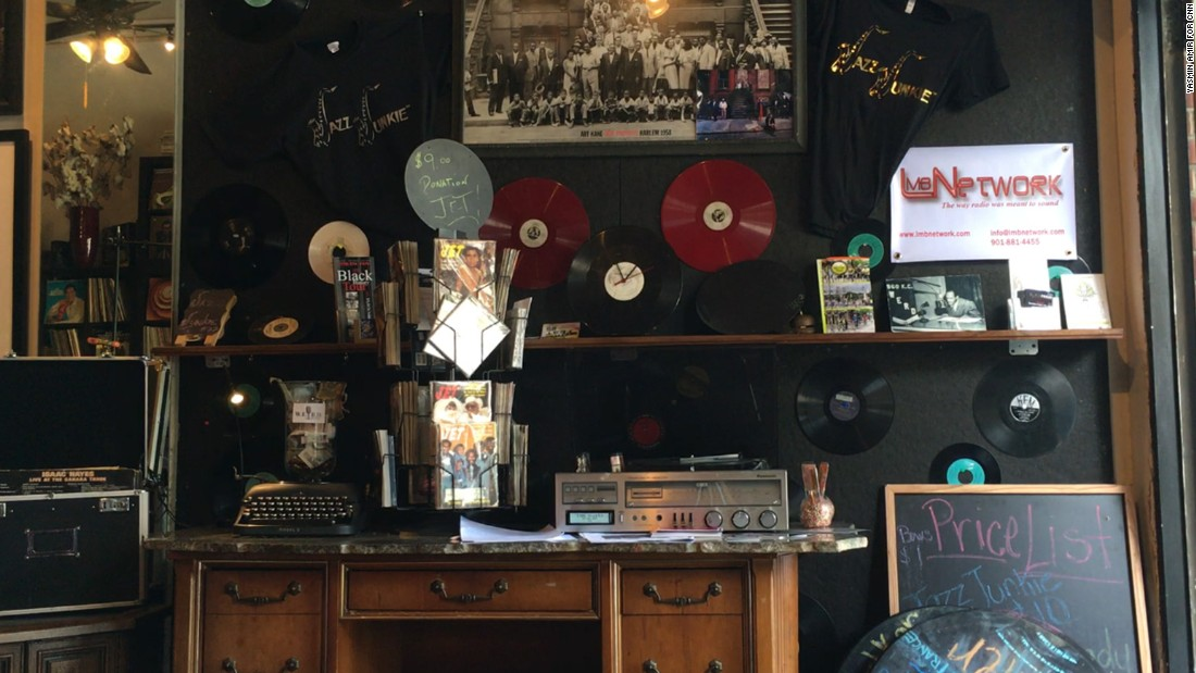 The walls and shelves are decorated with old records and radio paraphernalia.