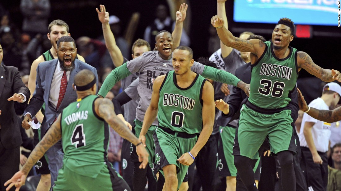 The Boston Celtics celebrate after Avery Bradley (No. 0) hit a buzzer-beating 3-pointer to win in Cleveland on Friday, February 5.