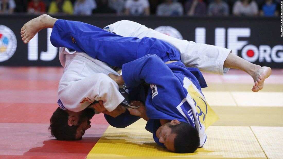 Japan's Hiroyuki Akimoto, right, competes against Georgia's Nugzari Tatalashvili at the Grand Slam judo tournament in Paris on Saturday, February 6. Akimoto won to take home the bronze medal in their weight class.