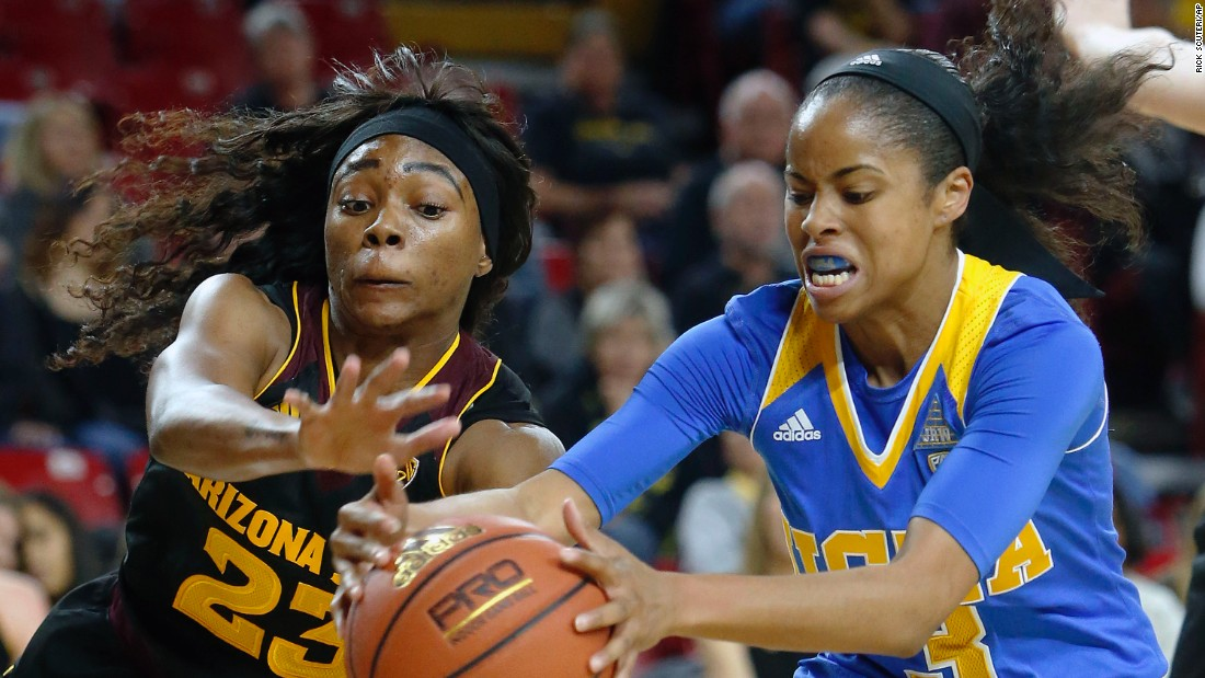 Arizona State's Elisha Davis, left, battles UCLA's Jordin Canada for a loose ball during a Pac-12 basketball game in Tempe, Arizona, on Friday, February 5.