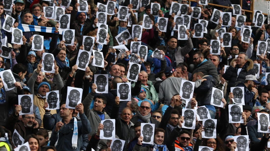 "During a Serie A soccer match on Sunday, February 7, fans of the Italian club Napoli hold up photos of Kalidou Koulibaly, a Napoli player <a href=""http://www.theguardian.com/football/2016/feb/04/lazio-napoli-serie-a-match-halted-due-to-racist-chanting-kalidou-koulibaly"" target=""_blank"">who had been the subject of racist chants</a> the previous week at Lazio."