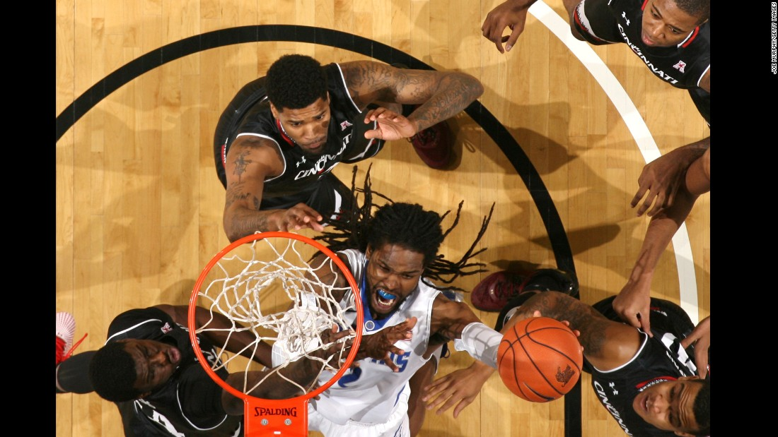 Memphis' Shaq Goodwin is surrounded by Cincinnati defenders as he shoots the ball Saturday, February 6, in Memphis, Tennessee.