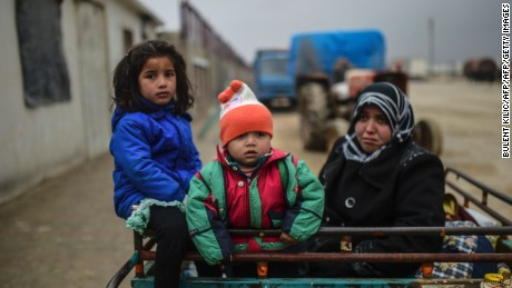 TOPSHOT - Refugee children arrive a the Turkish border crossing gate as Syrians fleeing the northern embattled city of Aleppo wait on February 6, 2016 in Bab al-Salama, near the city of Azaz, northern Syria. Thousands of Syrians were braving cold and rain at the Turkish border Saturday after fleeing a Russian-backed regime offensive on Aleppo that threatens a fresh humanitarian disaster in the country's second city. Around 40,000 civilians have fled their homes over the regime offensive, according to the Syrian Observatory for Human Rights monitor. / AFP / BULENT KILIC        (Photo credit should read BULENT KILIC/AFP/Getty Images)