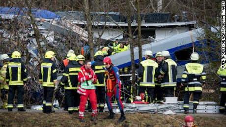 Firefighters and emergency doctors work at the site of a train accident near Bad Aibling, southern Germany, on February 9, 2016. Two Meridian commuter trains operated by Transdev collided near Bad Aibling, around 60 kilometres (40 miles) southeast of Munich, killing at least four people and injuring around 100, police said. The cause of the accident was not immediately clear. / AFP / dpa / Sven Hoppe / Germany OUT        (Photo credit should read SVEN HOPPE/AFP/Getty Images)