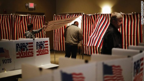 A voter steps into a voting booth to mark his ballot at a polling site for the New Hampshire primary, Tuesday, Feb. 9, 2016, in Nashua, N.H. (AP Photo/David Goldman)