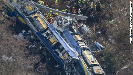 TOPSHOT - Aerial view shows firefighters and emergency doctors working at the site of a train accident near Bad Aibling, southern Germany, on February 9, 2016. Two Meridian commuter trains operated by Transdev collided head-on near Bad Aibling, around 60 kilometres (40 miles) southeast of Munich, killing at least eight people and injuring around 100, police said. The cause of the accident was not immediately clear. / AFP / dpa / Peter Kneffel / Germany OUT        (Photo credit should read PETER KNEFFEL/AFP/Getty Images)