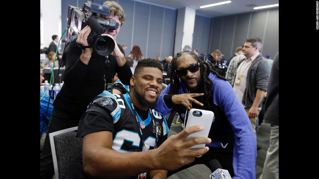 Carolina Panthers defensive tackle Daryl Williams takes a selfie with rapper Snoop Dogg at a Super Bowl press conference in San Jose, California, on Thursday, February 4.