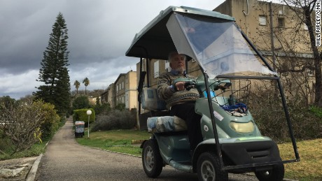 At Shaar Ha'amakim, senior citizens drive golf carts down quiet roads.