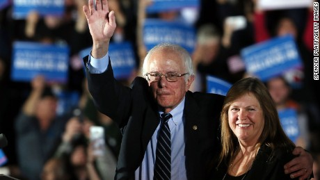 Sen. Bernie Sanders (D-VT) and his wife Jane O'Meara Sanders wave to supporters onstage after declaring victory over Hillary Clinton in the New Hampshire Primary onFebruary 9, 2016 in Concord, New Hampshire.