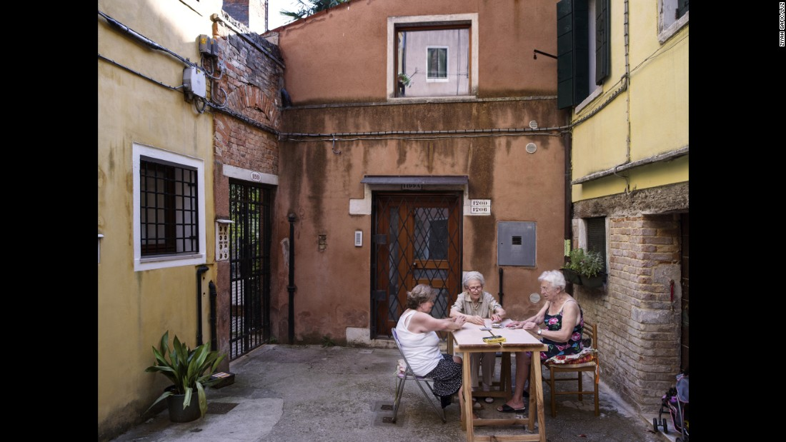 Ghetto residents play cards in a courtyard.