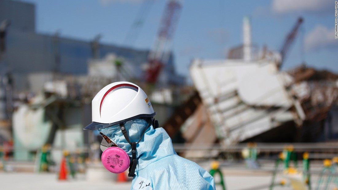 A TEPCO employee walks past the No. 1 reactor at the Fukushima Daiichi nuclear plant on February 10, 2016. Next month, Japan will mark the fifth anniversary of the Fukushima disaster, when an earthquake and tsunami hit on March 11, 2011, leaving more than 15,000 people dead.