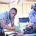Africa solar bus Uganda bus staff