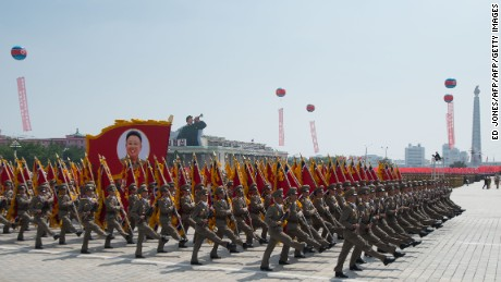 In a photo taken on July 27, 2013 North Korean soldiers march on Kim Il-Sung square during a military parade marking the 60th anniversary of the Korean war armistice in Pyongyang. North Korea mounted its largest ever military parade July 27 to mark the 60th anniversary of the armistice that ended fighting in the Korean War, displaying its long-range missiles at a ceremony presided over by leader Kim Jong-Un.    AFP PHOTO / Ed Jones        (Photo credit should read Ed Jones/AFP/Getty Images)