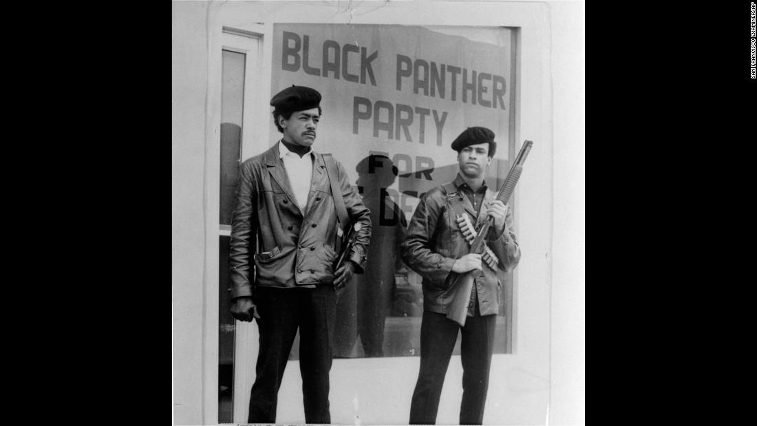 Black Panther National Chairman Bobby Seale, left, wears a Colt .45, and Huey Newton, right, carries a shotgun in Oakland, California, in the 1960s. The group's look and defiant rhetoric made black militancy fashionable in the late '60s.