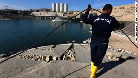 An employee works at strengthening the Mosul Dam on the Tigris River, around 50 kilometres north of the Iraqi city of Mosul, on February 1, 2016. The United States is monitoring Iraq's largest dam for signs of further deterioration that could point to an impending catastrophic collapse, US army officers said on January 28, 2016. The Islamic State (IS) jihadist group seized the Mosul Dam briefly in 2014, leading to a lapse in maintenance that weakened an already flawed structure, and Baghdad is seeking a company to make repairs. / AFP / SAFIN HAMED        (Photo credit should read SAFIN HAMED/AFP/Getty Images)