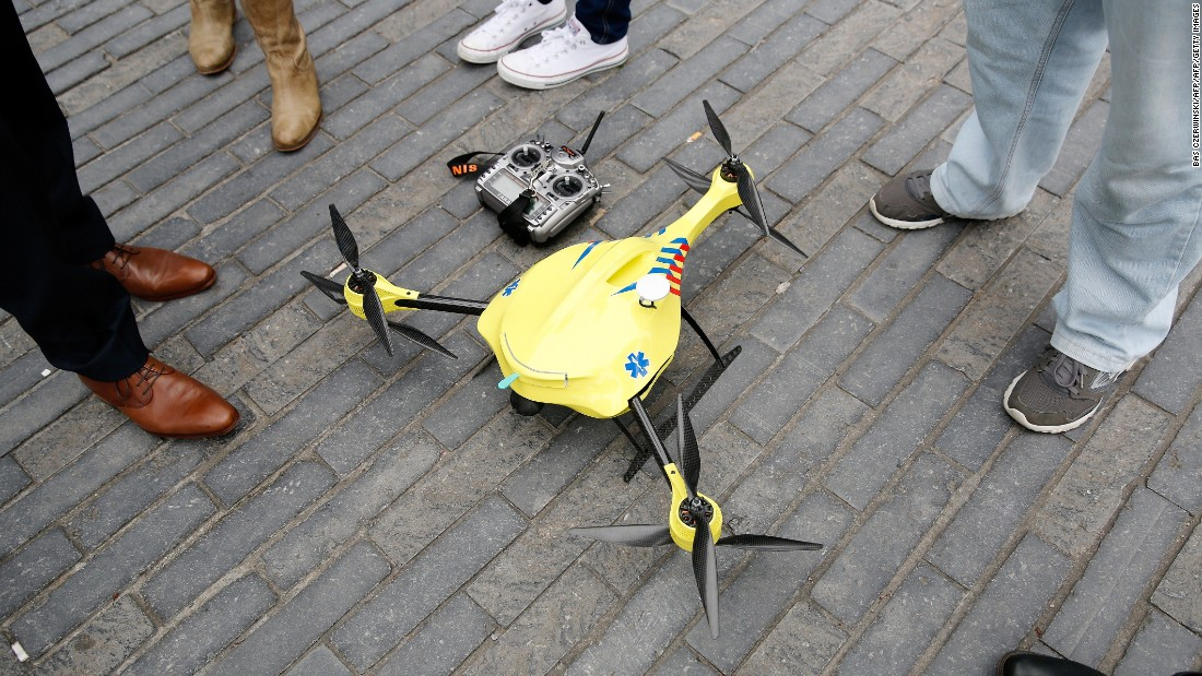 As drones have become more popular and widely available a variety of uses have sprung up. Pictured, a prototype ambulance drone, developed by scientists at Delft technical university, carrying an in-built defibrillator.