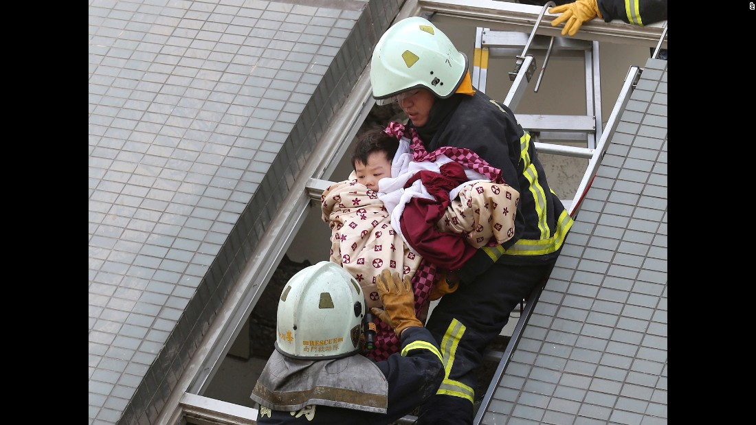 "A child is rescued from a toppled building in Tainan, Taiwan, after <a href=""http://www.cnn.com/2016/02/07/asia/taiwan-earthquake/"" target=""_blank"">a magnitude-6.4 earthquake struck</a> on Saturday, February 6. At least 37 people were killed in the earthquake, authorities said."