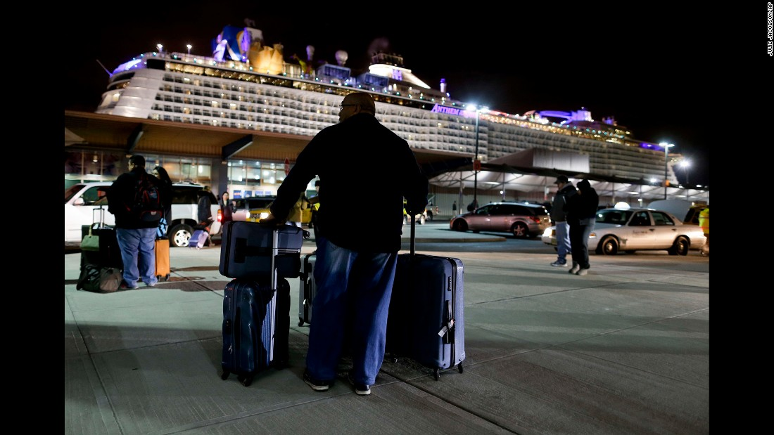 "A passenger of Anthem of the Seas, a Royal Caribbean cruise ship, waits for a ride after the boat docked in Bayonne, New Jersey, on Wednesday, February 10. The cruise <a href=""http://www.cnn.com/2016/02/10/us/new-jersey-anthem-of-seas-cruise-ship-extreme-storm/"" target=""_blank"">ended early</a> after the ship sailed into a rough storm in the Atlantic, and Royal Caribbean apologized to passengers. ""If we knew that we were going to have those kinds of winds, the winds that we actually experienced with the ship, we would not have sailed into that,"" Bill Baumgartner, the company's senior vice president of global marine operations, told CNN."