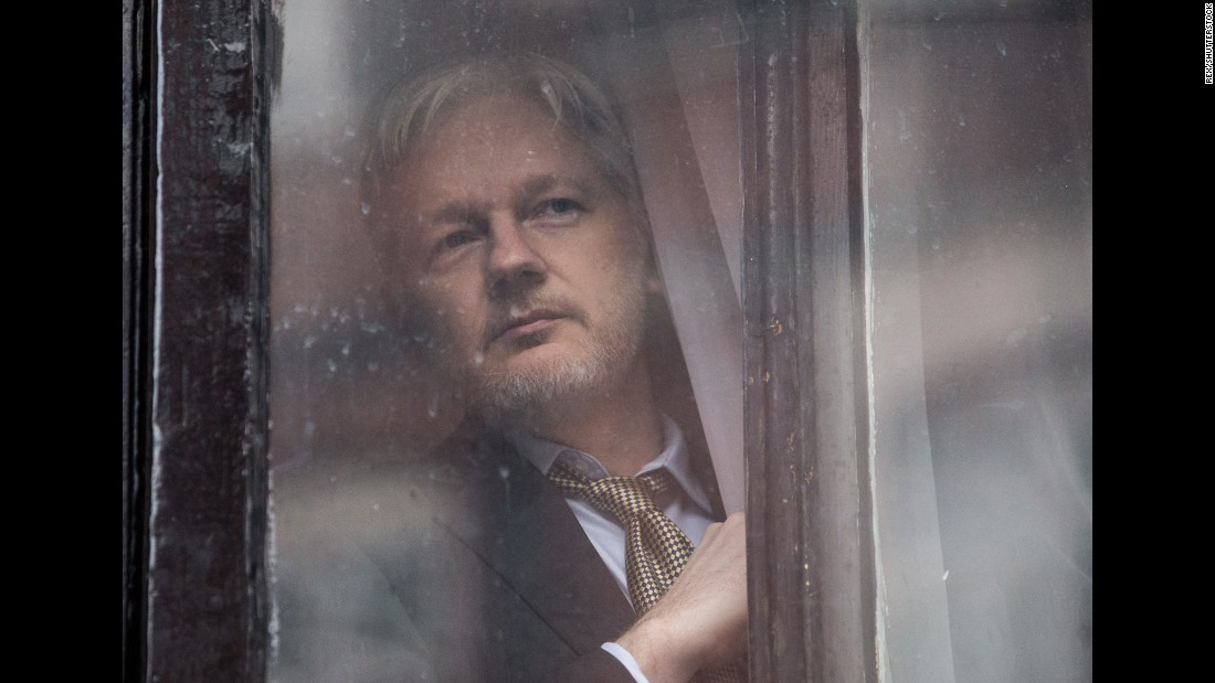 "WikiLeaks founder Julian Assange looks out of a door at the Ecuadorian Embassy in London on Friday, February 5. Assange expressed vindication over <a href=""http://www.cnn.com/2016/02/05/europe/julian-assange-ruling/index.html"" target=""_blank"">a U.N. panel's judgment </a>that the Swedish and UK governments have ""arbitrarily detained"" him since 2010."