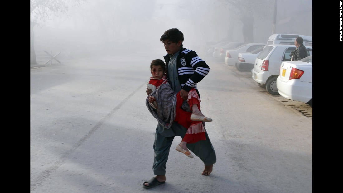 "A boy carries an injured girl from the site of a bombing in Quetta, Pakistan, on Saturday, February 6. A man rammed his explosive-laden motorcycle into a Pakistani security force vehicle, <a href=""http://www.cnn.com/2016/02/06/asia/pakistan-suicide-attack/"" target=""_blank"">setting off a blast</a> that killed at least eight people and injured about 20 others, officials said. The Pakistani Taliban claimed responsibility for the attack."