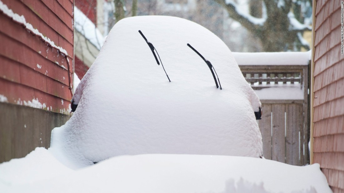A car is buried under snow following a snowstorm in Halifax, Nova Scotia, on Tuesday, February 9.