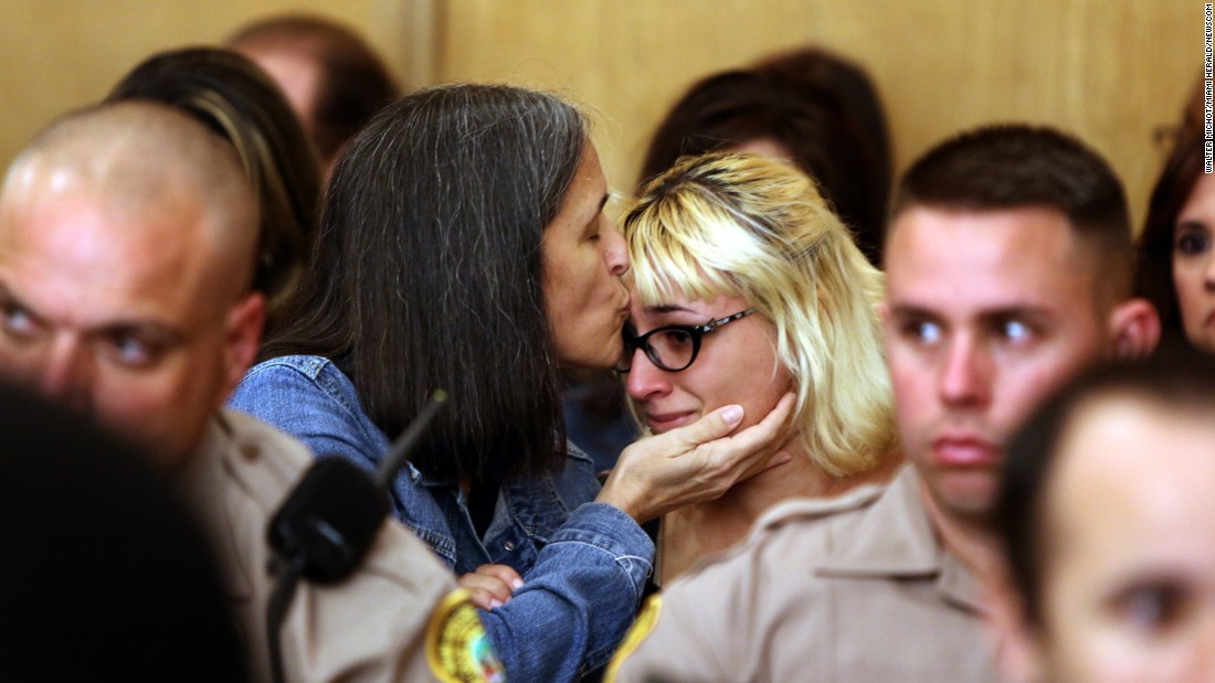 Carolyn Knox, mother of Jennifer Alfonso, kisses a relative during the sentencing of Derek Medina on Friday, February 5. Medina was sentenced to life in prison for killing Alfonso, his wife, in 2013.