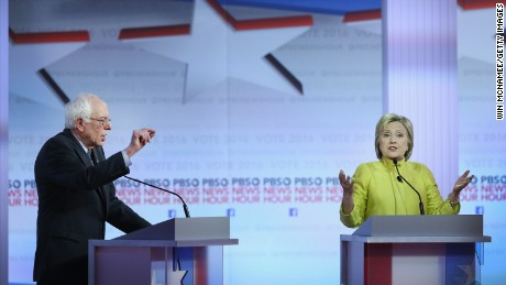 Democratic presidential candidates Senator Bernie Sanders (L) and Hillary Clinton participate in the PBS NewsHour Democratic presidential candidate debate at the University of Wisconsin-Milwaukee on February 11, 2016 in Milwaukee, Wisconsin.