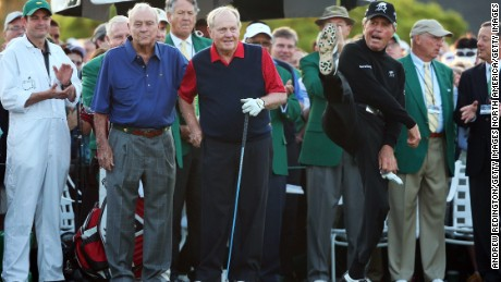 Player (right) demonstrates his agility with Arnold Palmer and Jack Nicklaus at Augusta in 2015