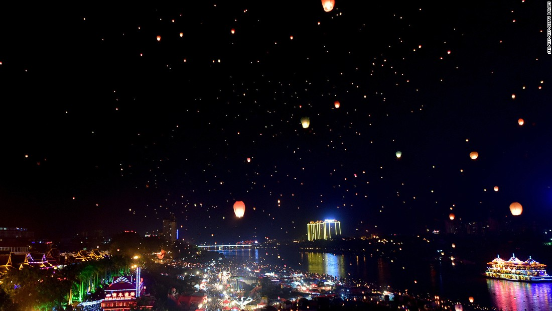 Dai people celebrate their new year by splashing water and releasing thousands of sky lanterns.