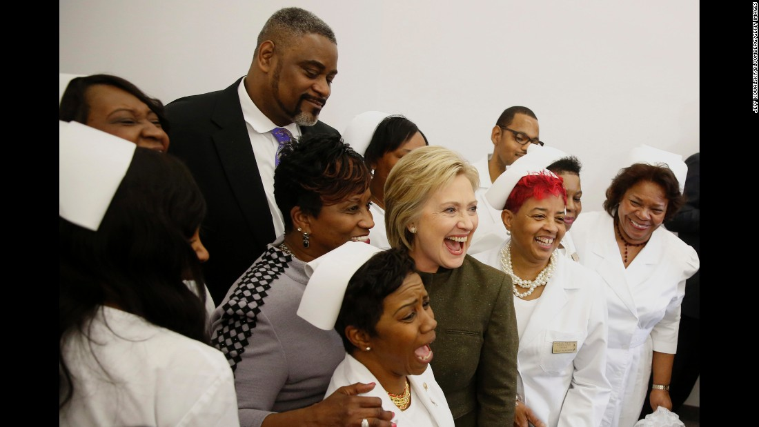 "Democratic presidential candidate Hillary Clinton takes a photograph Sunday, February 9, at the House of Prayer Missionary Church in Flint, Michigan. <a href=""http://www.cnn.com/2016/02/07/politics/hillary-clinton-flint-michigan-water-2016-election/"" target=""_blank"">Clinton promised Flint residents,</a> whose lives have been turned upside down by the city's ongoing water crisis, that she will be their partner in what is sure to be a long recovery."