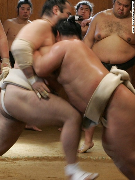 "OSAKA, JAPAN - MARCH 01:  Sumo wrestlers take part in a training session during a ""Sumo Diet Campaign"" event at Musashigawa Sumo Stable on March 1, 2007 in Osaka, Japan. The Sumo Stable holds open day events for sumo fans to watch their training sessions, take part in sumo exercise classes and eat 'chanko-nabe' or 'sumo stew'; a favourite dish in the diet of sumo wrestlers. The next sumo wrestling tournament is due to start on March 11 in Osaka.  (Photo by Junko Kimura/Getty Images)"