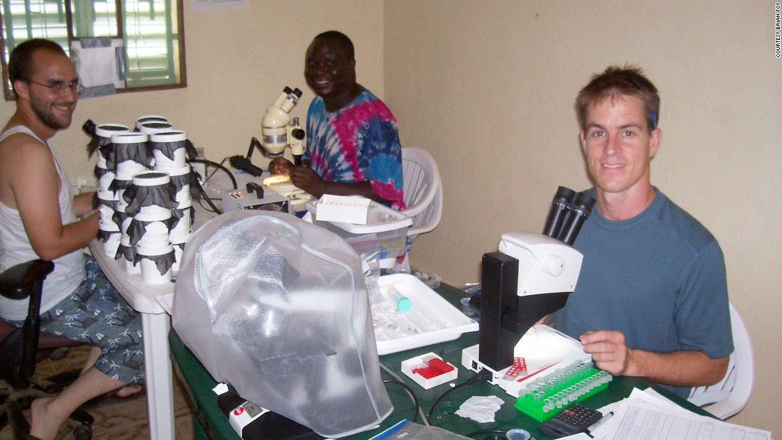 From left: Kobylinski, Sylla and Foy dissect dead mosquitoes in their makeshift Senegal lab.