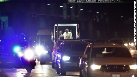 Pope Francis waves from the Popemobile upon his arrival in Mexico City on February 12, 2016. Catholic faithful flocked to the streets of Mexico City to greet Pope Francis on Friday after the pontiff held a historic meeting with the head of the Russian Orthodox Church in Cuba. AFP PHOTO/Yuri Cortez / AFP / YURI CORTEZ        (Photo credit should read YURI CORTEZ/AFP/Getty Images)