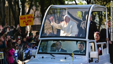 Pope Francis waves from the popemobile on his way to the National Palace, in Mexico City on February 13, 2016. Francis will be the first pope to enter Mexico's National Palace to meet President Enrique Pena Nieto, as he starts a cross-country tour that will highlight the country's violence and migration troubles.   AFP PHOTO / RONALDO SCHEMIDT / AFP / RONALDO SCHEMIDT        (Photo credit should read RONALDO SCHEMIDT/AFP/Getty Images)