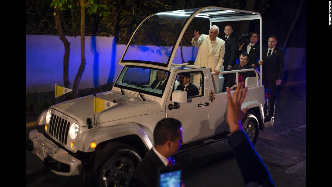 Pope Francis waves to people as he arrives to the Vatican's diplomatic mission in Mexico City on February 12.