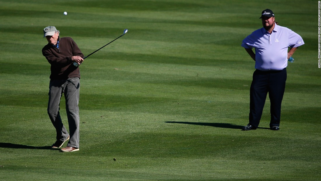 "He may be 85-years-old but this his punk is still hoping to feel lucky on the course this weekend. Actor and director, Clint Eastwood swings an iron of the third fairway at Pebble Beach.  The star of ""Dirty Harry"" and ""Escape from Alcatraz"" was previously mayor of the nearby city of Carmel."