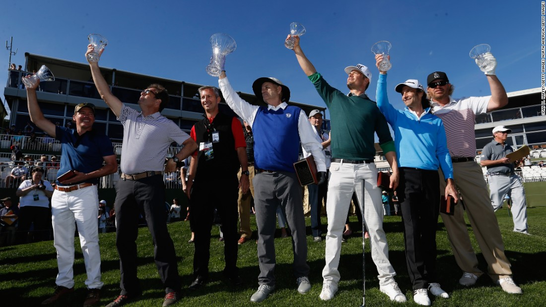 All for one! From left to right, Musician Clay Walker, Musician Huey Lewis, Comedian Bill Murray, Actor Josh Duhamel, Musician Kenny G, and Musician Toby Keith pose for the cameras at the beginning of the Pebble Beach Pro-Am golf tournament in Pebble Beach, California.