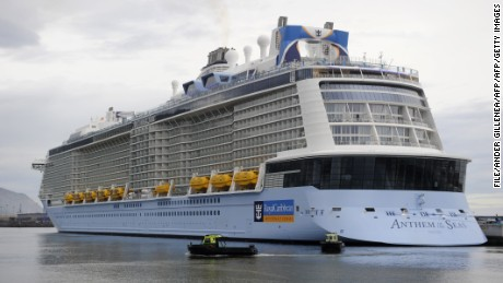 The Royal Caribbean's latest cruise liner 'Anthem Of The Seas', the third largest ship in the world, is moored at the port of Bilbao during its maiden voyage, on April 26, 2015. The 'Anthem Of The Seas', a 4,905-passenger ship, is billed as the most technologically advanced cruise vessel ever. It boasts fast internet speeds, an all-digital check-in process, a skydiving simulator at sea and the first bumper cars at sea.   AFP PHOTO/ ANDER GILLENEA        (Photo credit should read ANDER GILLENEA/AFP/Getty Images)