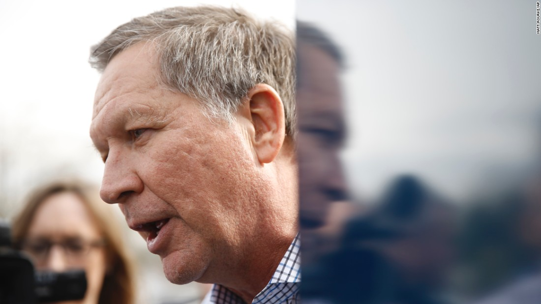 Republican presidential candidate Ohio Gov. John Kasich meets with people during a campaign stop on Friday, February 12, in Orangeburg, South Carolina.