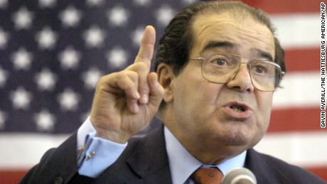 FILE - In this Wednesday, April 7, 2004 file photo, U.S. Supreme Court Justice Antonin Scalia speaks to Presbyterian Christian High School students in Hattiesburg, Miss. On Saturday, Feb. 13, 2016, the U.S. Marshall's Service confirmed that Scalia has died at the age of 79. (Gavin Averill/The Hattiesburg American via AP