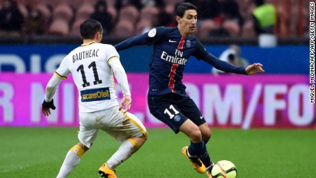 Paris Saint-Germain forward Angel Di Maria (R) vies for the ball with Lille's French midfielder Eric Bautheac.