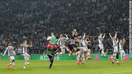 Juventus players celebrate after defeating title rival Napoli.