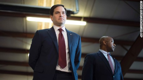 Republican presidential candidate Marco Rubio (L) stands on stage with US Senator Tim Scott, R-South Carolina, during a rally in Greenville, South Carolina, February 12, 2016.