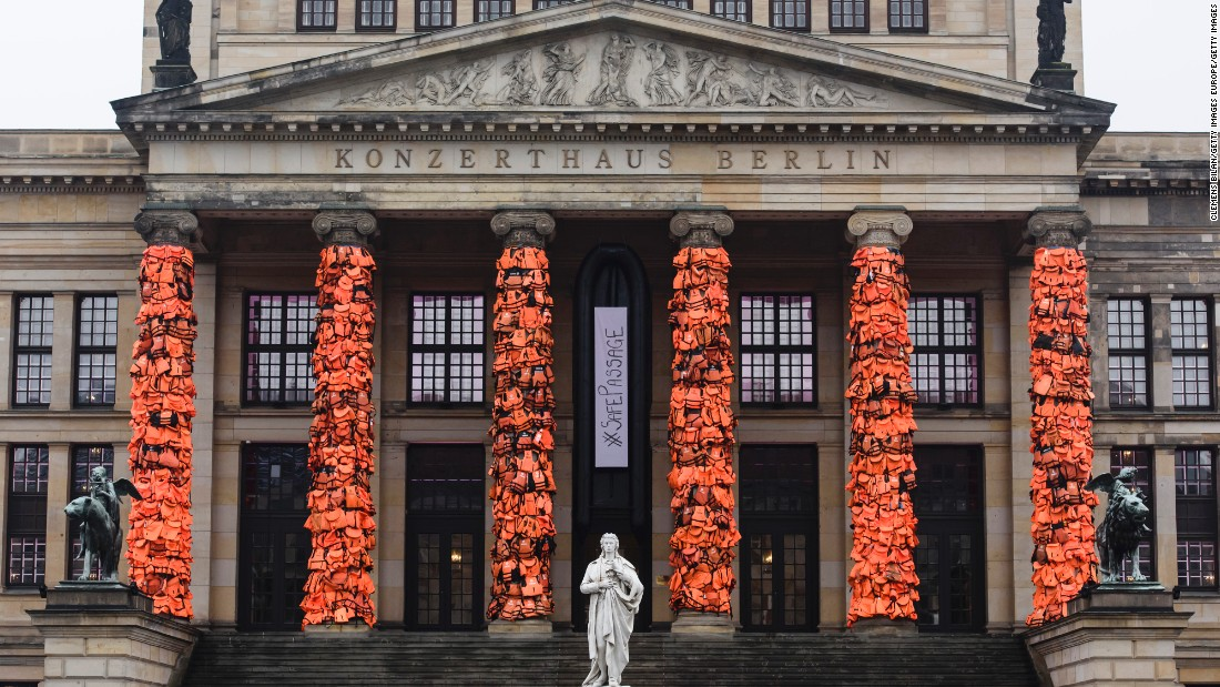 "Renowned Chinese artist Ai Weiwei covered the columns of the Gendarmenmarkt concert hall in Berlin with <a href=""http://edition.cnn.com/2016/02/14/arts/ai-weiwei-berlin-life-jackets/"">14,000 discarded life jackets</a> to highlight the number of migrants taking to the seas every day."