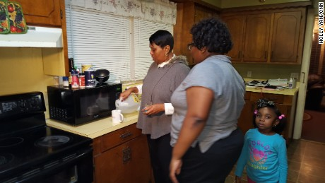 Glynis Watson Cephus, left, makes coffee with bottled water. Her daughter Sydney Cephus and granddaughter Hailey Birdon don't drink the tap water, either.